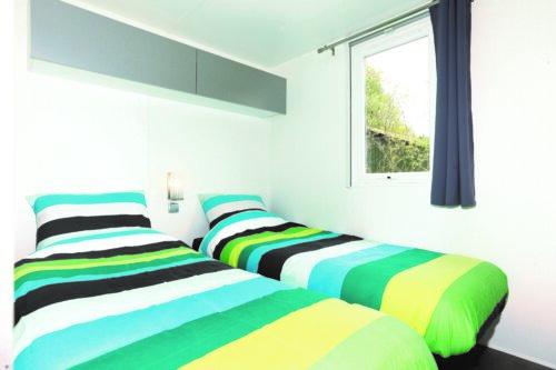 Slaapkamer chalet 34 Camping Zonnkamp